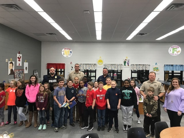 Officers with 4th grade.