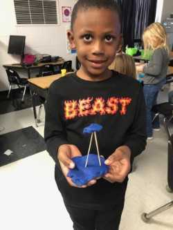 Student shows 3-D creation.