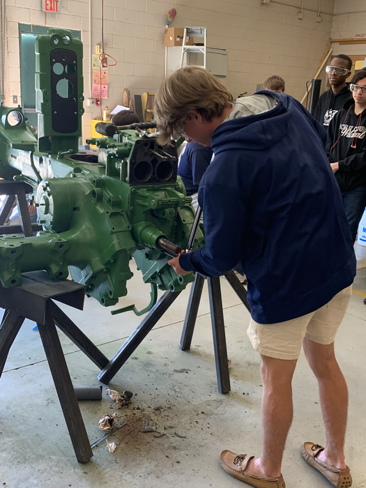 Mr. Sellers' AG class restoring an old John Deere tractor engine.